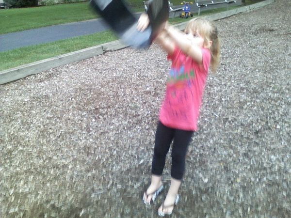 Breaking from laundry & Addi quickly learned not to push mommy on the swings :)