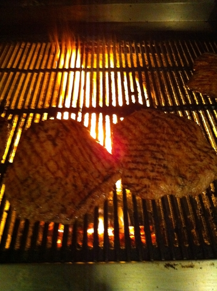 Beautiful grassfed Tallgrass flank steak--roasted green chile&garlic marinade--on the wood grill in Frontera.