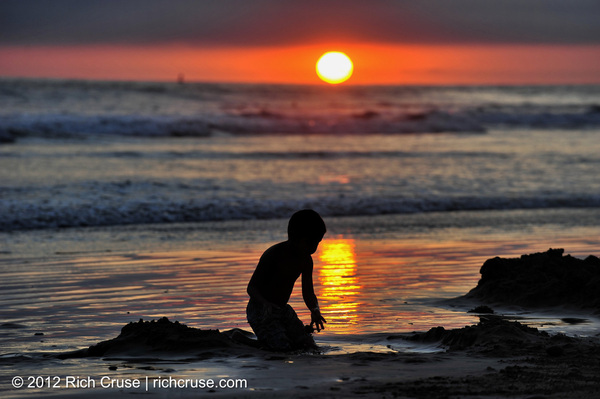 Boy plays in the sand at sunset @VisitOceanside @VisitCA - August 5, 2012.