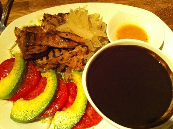 A beautiful plate of Poc Chuc estilo Maní (black bean caldo, habanero salsa) in Frontera. My dinner :)