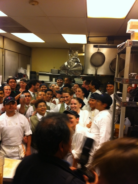 President insisted on going into Frontera kitchen to get a pic w staff. He's in back in middle;his photog n front