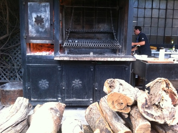 1884, Francis Mallman Resto: outdoor grill. Firebox on left to burn wood to coals. As coals fall, transfer under grill
