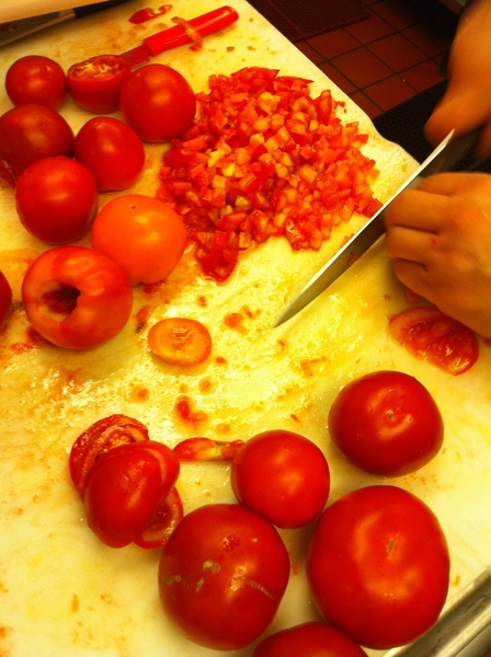 There are great-looking, aromatic, ripe tomatoes being prepped on nearly every table in our kitchens!