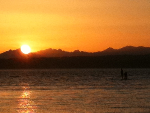 A couple of SUP lovers worked hard to get to see the Olympic Mts sunset today! #DiscoveryPark