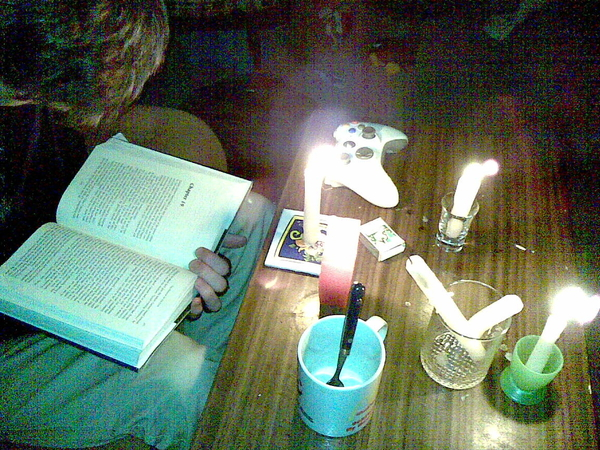 Jon reading by candle light