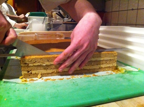 Slicing an amazing roasted banana cake for Topolo tonight!