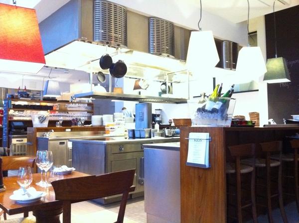 In Copenhagen@Nimb Brasserie. Blown away w design: kitchen integrated n2 dining room, stunning modern, warm design