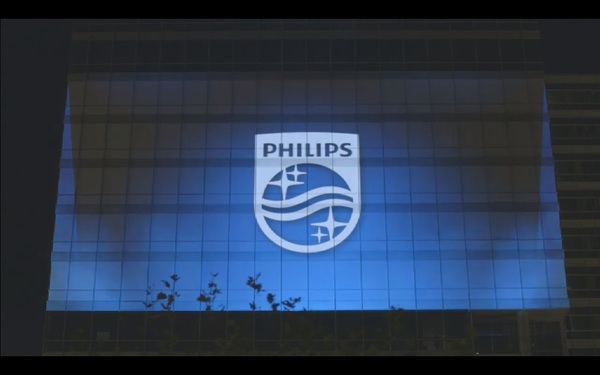 New Philips brand logo projected on Philips headquarters Amsterdam