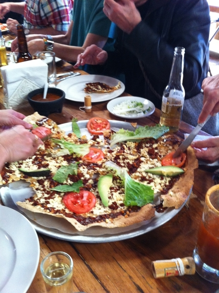 La Capilla Resto, Zaachila, Oaxaca: huge, crispy tlayuda from woodburning oven w chorizo and coloradito drizzle