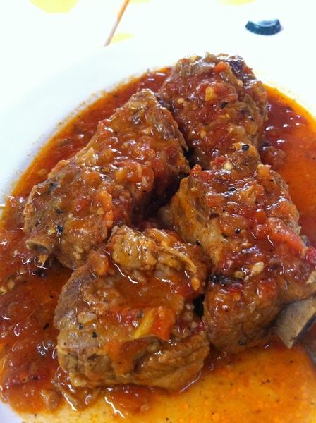 Carmelita's: pork ribs braised w heirloom tomatoes, serrano, garlic, herbs. Unbelievable tomato flavor!