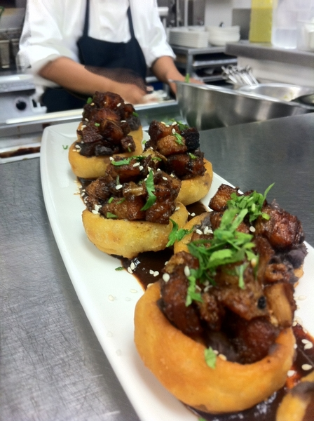 In LA at Red O. Serving pork belly sopes with bl beans & salsa negra for Ixtapa Wine&Food Festival press party