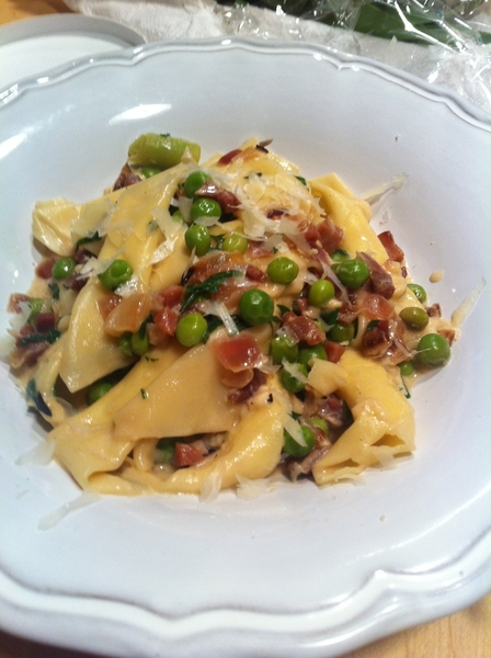 Finished garganelli pasta dish w fresh peas, prosciutto, herbs from garden, homemade crema, kaskaskia cheese