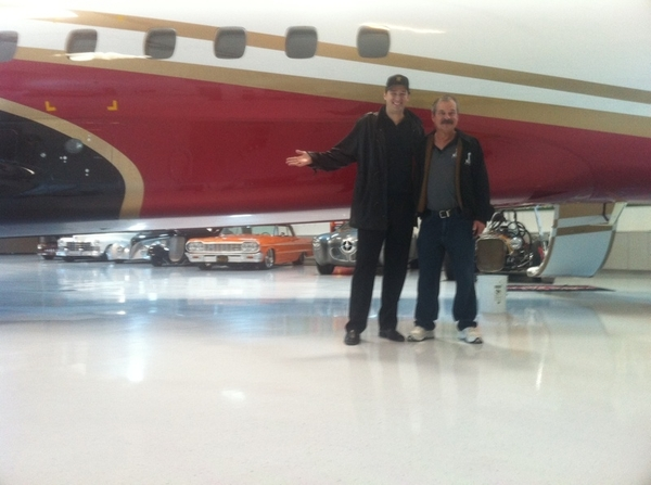 COOL PIC: Ernie's airplane hangar! Ernie Moody + I with his jet + cars. @cfields @balsbaugh + @bobsoderstrom w me