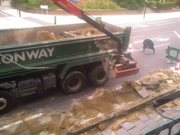grabby lorry eats pavement